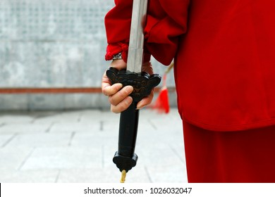 Hand holding sword during tai chi in Shanghai , china