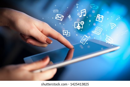 Hand holding tablet with drawn multimedia and application icons