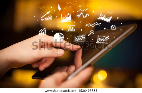 Hand holding tablet with online business report concept