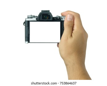 Hand holding and taking shot with blank display mirrorless camera isolated