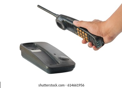 Hand holding telephone on service connection, isolated white background with clipping path