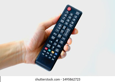 Hand holding television and audio remote control isolate on white background