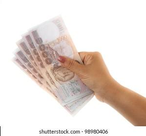 Hand holding thai money on white background.
