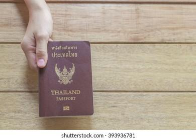 hand holding a thailand Passport