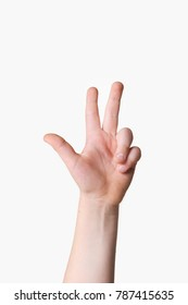 Hand holding up three fingers on a white background