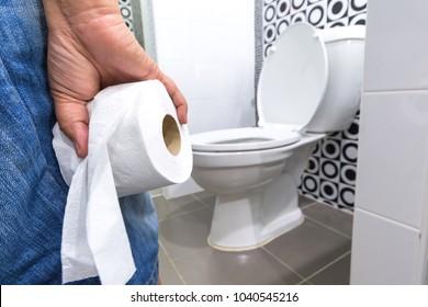 Hand holding Toilet Paper.diarrhea constipation .Health concept