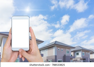 hand holding and touch screen smartphone, looking for a new houses in suburb.