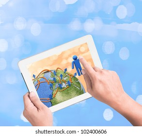 hand holding a touchpad pc with growthing graph