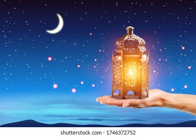 Hand holding traditional Arabic lantern - Shutterstock ID 1746372752