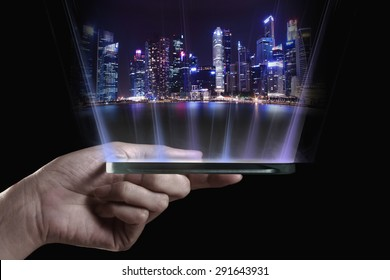 Hand holding transparent 3D smartphone. A 3D phone is a mobile phone that conveys depth perception to the viewer by employing stereoscopy or any other form of 3D depth techniques.