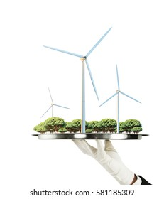 Hand holding tray with abstrat landscape and windmills on white background. 3D Rendering. Environment concept