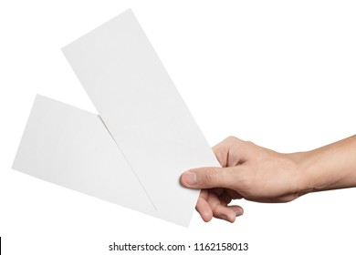 Hand holding two blank sheets of paper (tickets, flyers, invitations, coupons, banknotes, etc.), isolated on white background