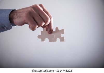 Hand holding two jigsaw puzzle piece. Success and Business