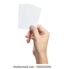 Hand holding two small pieces of paper or plastic (cards, tickets, flyers, invitations, coupons, banknotes, etc.), isolated on white background