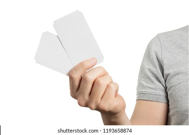 Hand holding two tickets, flyers, invitations, coupons, etc.), isolated on white background