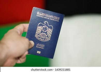 hand holding UAE passport -  - abudhabi /uae - 01/Jul/2019