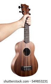 Hand holding ukulele on isolated white background