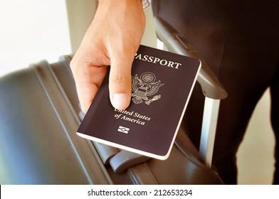 Hand holding U.S. passport - brown sepia effect