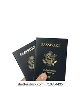 Hand holding US passport isolated on white background