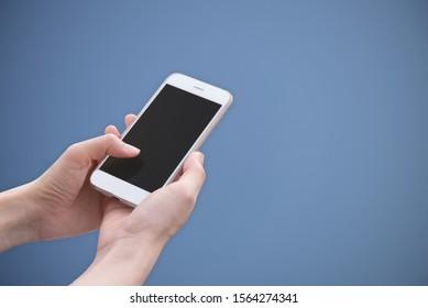 hand holding using mobile phone.girl using smart phone.