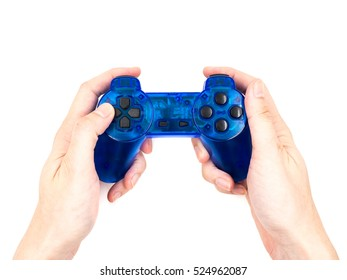 Hand holding video game controller on white background