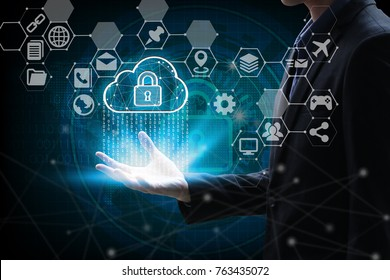hand holding with virtual screen cloud computing and Interface Icons global network  Cyber Security Data Protection Business Technology Privacy concept, Internet Concept of cloud computing concept.