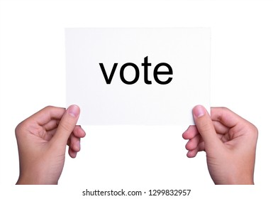 hand holding voting card