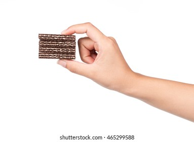 hand holding wafer biscuits isolated on white background