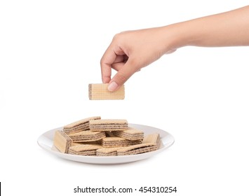 hand holding waffles on dish isolated on white background