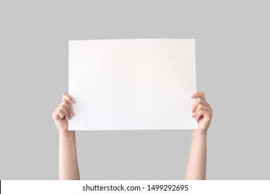 hand holding white blank paper isolated on grey background with clipping path