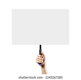 Hand holding a white blank plate with a handle. Close up. Isolated on white background