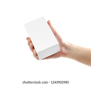 Hand holding white box. Close up. Isolated on white background
