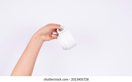 hand holding a white cup with elegant nail polish, beauty manicure - Shutterstock ID 2013405728