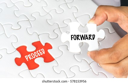 Hand holding white jigsaw puzzle with conceptual text.