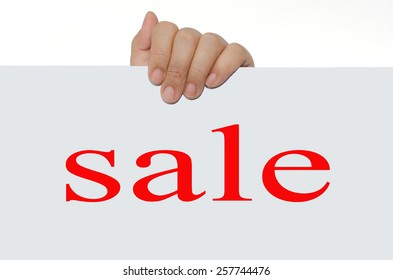 Hand holding white label word SALE on white background