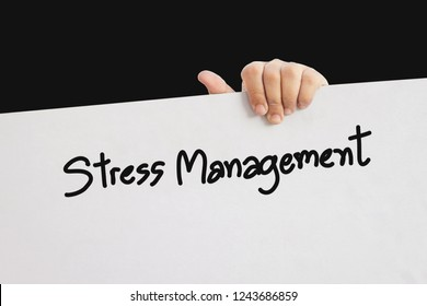 hand holding white paper board with stress management word