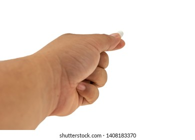 Hand holding white pill isolated on white background with clipping path.