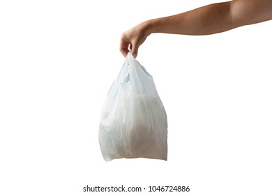 Hand holding white plastic bag of garbage isolated on white background
