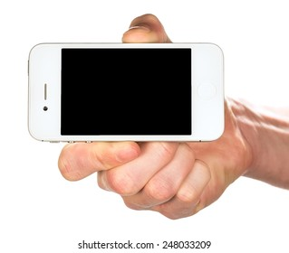 Hand holding a white smartphone with black screen isolated on white background