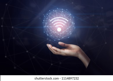 Hand holding wifi network connection icon. Innovation technology concept.