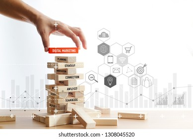 Hand holding wooden block with digital marketing word with icon digital network connection on wooden blocks structure white background. Digital marketing concept.
