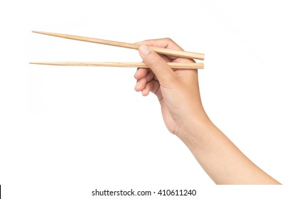 hand holding Wooden chopsticks isolated on white background