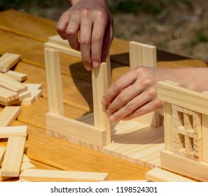 Hand holding  wooden puzzle element in hand