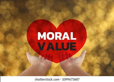 hand holding the Word moral Value with yellow glitter Background