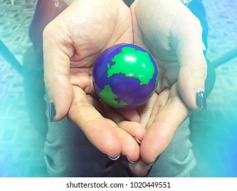 Hand holding the world map ball , care nature care world concept save the world