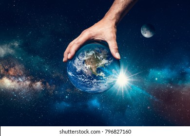 Hand holding the world, symbol that God is in control of everything.