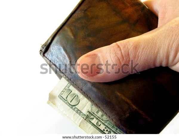 hand holding a worn wallet with money spilling out on white background