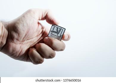 hand holding year of tolerance badge - isolated - abudhabi /uae - 21/april/2019