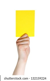 hand holding a yellow card (sports), isolated on white
