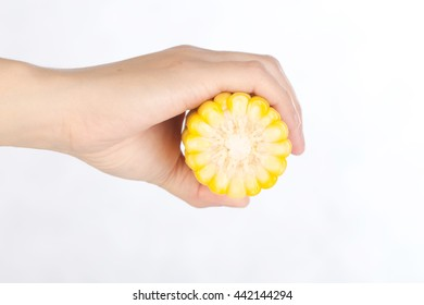Hand holding yellow corn  on white background,selective focus